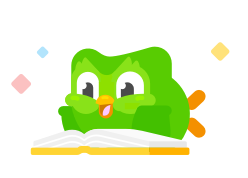 image of Duo the owl lying on the floor happily reading a book. He looks excited and little colorful  sparkles are circling him