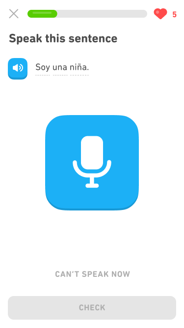 "Screenshot of an exercise with the prompt ""Speak this sentence."" Below the prompt is a blue audio button and the Spanish sentence ""Soy una niña."" In the center of the screen is a large blue microphone button for recording."