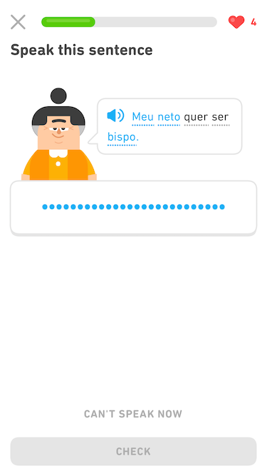"Screenshot of the same exercise. The prompt states ""Speak this sentence."" The Duolingo character Lin appears next to a speech bubble, which has a blue audio button and a sentence in Portuguese. Now the first, second, and fifth Portuguese words are in blue and the third and fourth are in black. Below Lin and the speech bubble is a long button that is now filled with a line of blue dots indicating that audio is being recorded."