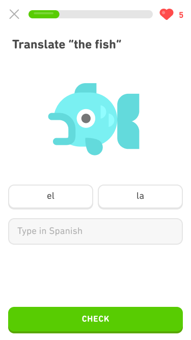 Screenshot of an exercise with the prompt 'Translate 'the fish'' and a large image of a fish. Below the fish are two buttons, one says 'el' and the other says 'la' (the Spanish words for 'the'), and below them is a blank for the learner to type the word in Spanish.