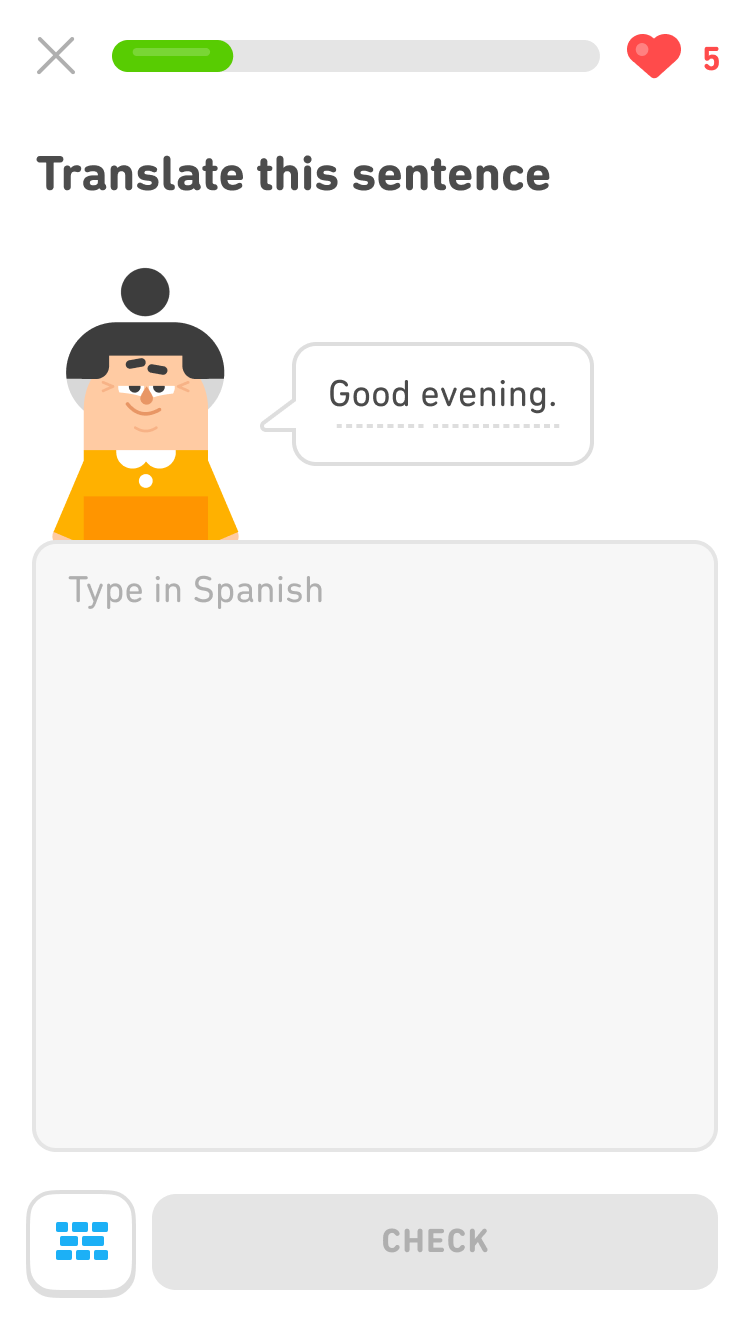 "Screenshot of the same exercise as above, with the prompt ""Translate this sentence"" and an image of the Duolingo character Lin and a speech bubble saying ""Good evening."" Below the character is an empty field for the learner to type their response in Spanish. To the left of the gray ""Check"" button is a blue icon of a word bank."