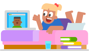 Image of a young woman lying stomach-down on a bed with a laptop open before her. She is videochatting with a man, and she is talking and gesturing towards the laptop. There is a cup of water on the floor at the edge of the bed, and there is a pile of books next to it.