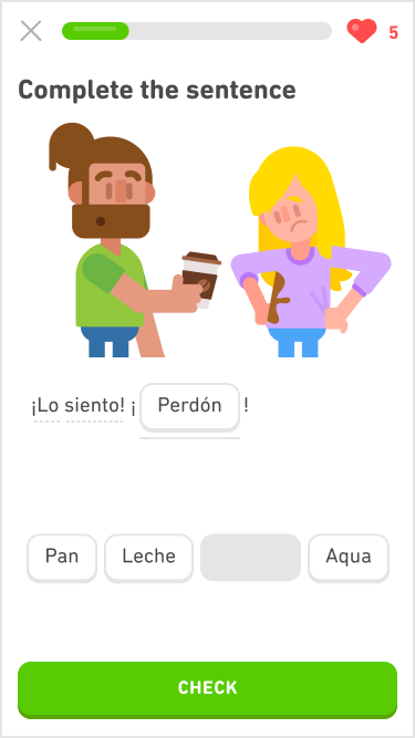 "Screenshot of an immersion exercise in the Spanish course for English speakers. The instructions say ""Complete the sentence"" and below is an image of two people. On the left is a man with a brown beard and brown hair pulled back into a bun. He has a green t-shirt and his eyebrows are raised in surprise and his mouth is opened. He is holding out a to-go cup of coffee to the other person. On the right is a woman with long blonde hair looking down in disappointment at her purple shirt with a large coffee stain. Below the image is two sentences in Spanish, and the second one was a fill-in-the-blank that has been filled in with one of the words from the word bank below."