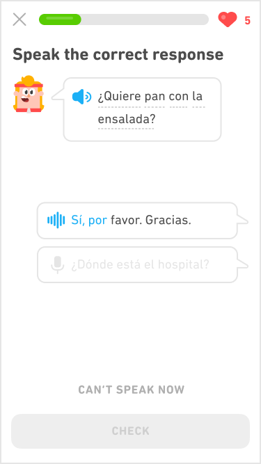 "Screenshot of an immersion exercise in the Spanish course for English speakers. The instructions say ""Speak the correct response"" and below is Eddy's head speaking a line of Spanish dialogue. Eddy has chin-length blonde hair held back by a red headband that matches his red tracksuit. His line of dialgue is in a speech bubble, and below are two response speech bubbles for the learner to choose for an answer."